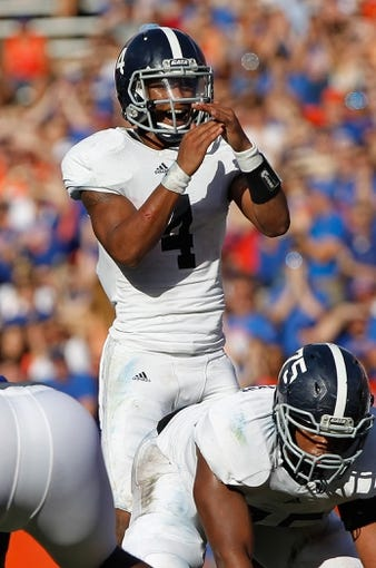 Nov 23, 2013; Gainesville, FL, USA; Georgia Southern Eagles quarterback Kevin Ellison (4) calls a timeout against the Florida Gators during the second quarter at Ben Hill Griffin Stadium. Mandatory Credit: Kim Klement-USA TODAY Sports