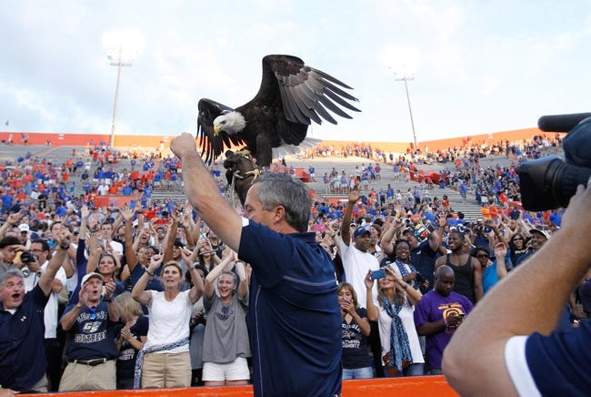 Nov 23, 2013; Gainesville, FL, USA; Georgia Southern Eagles hold up their mascot the eagle after they beat the Florida Gators at Ben Hill Griffin Stadium. Georgia Southern Eagles defeated the Florida Gators 26-20. Mandatory Credit: Kim Klement-USA TODAY Sports