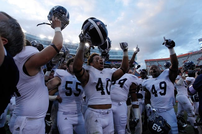 Nov 23, 2013; Gainesville, FL, USA; Georgia Southern Eagles linebacker Edwin Jackson (40) celebrates and reacts with players after they beat the Florida Gators at Ben Hill Griffin Stadium. Georgia Southern Eagles defeated the Florida Gators 26-20. Mandatory Credit: Kim Klement-USA TODAY Sports
