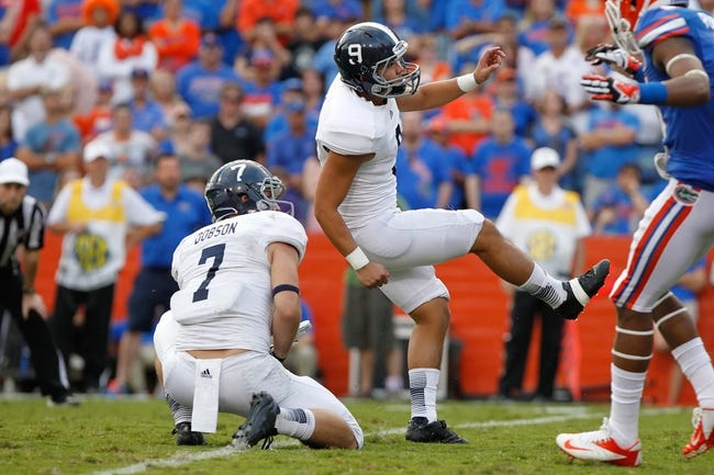 Nov 23, 2013; Gainesville, FL, USA; Georgia Southern Eagles kicker Younghoe Koo (9) kicks a field goal against the Florida Gators during the second half at Ben Hill Griffin Stadium. Georgia Southern Eagles defeated the Florida Gators 26-20. Mandatory Credit: Kim Klement-USA TODAY Sports