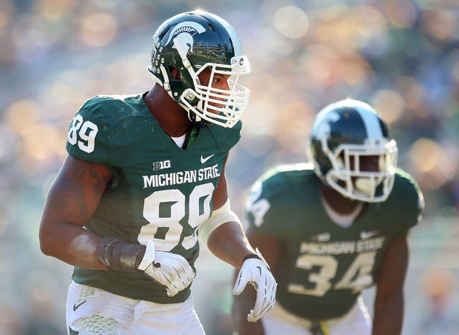 Nov 30, 2013; East Lansing, MI, USA;Michigan State Spartans defensive end Shilique Calhoun (89) stands on the field  during the 2nd half a game against the Minnesota Golden Gophers at Spartan Stadium. MSU won 14-3.  Mandatory Credit: Mike Carter-USA TODAY Sports
