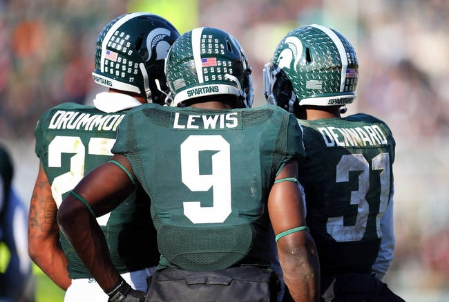 Nov 30, 2013; East Lansing, MI, USA; Michigan State Spartans safety Kurtis Drummond (27) and safety Isaiah Lewis (9) and cornerback Darqueze Dennard (31) during the 2nd half a game against the Minnesota Golden Gophers at Spartan Stadium. MSU won 14-3.  Mandatory Credit: Mike Carter-USA TODAY Sports