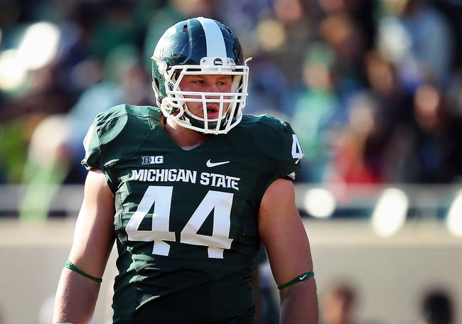 Nov 30, 2013; East Lansing, MI, USA; Michigan State Spartans defensive end Marcus Rush (44) stands on field during the 1st half a game against the Minnesota Golden Gophers at Spartan Stadium. Mandatory Credit: Mike Carter-USA TODAY Sports