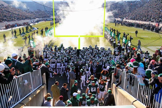 Nov 30, 2013; East Lansing, MI, USA; General view of Michigan State Spartans taking the field  prior to a game against the Minnesota Golden Gophers at Spartan Stadium. Mandatory Credit: Mike Carter-USA TODAY Sports