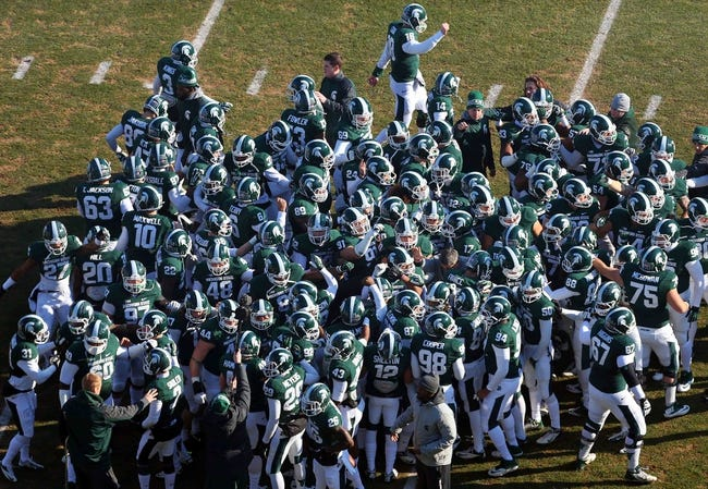 Nov 30, 2013; East Lansing, MI, USA; Michigan State Spartans players meet on field prior to a game against the Minnesota Golden Gophers at Spartan Stadium. Mandatory Credit: Mike Carter-USA TODAY Sports