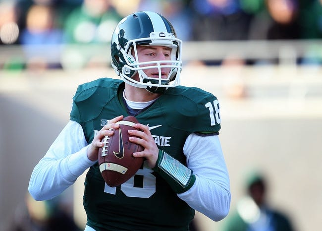 Nov 30, 2013; East Lansing, MI, USA; Michigan State Spartans quarterback Connor Cook (18) drops back to pass during the 1st half a against the Minnesota Golden Gophers game at Spartan Stadium. Mandatory Credit: Mike Carter-USA TODAY Sports