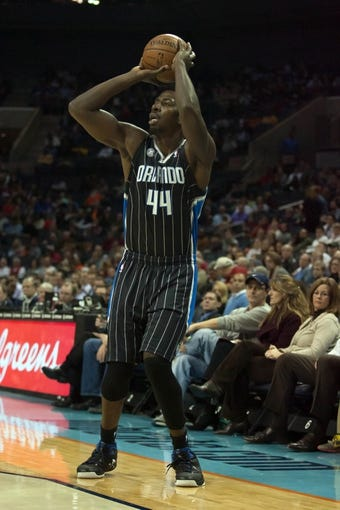 Dec 11, 2013; Charlotte, NC, USA; Orlando Magic power forward Andrew Nicholson (44) shoots a three point shot during the first half against the Charlotte Bobcats at Time Warner Cable Arena. Mandatory Credit: Jeremy Brevard-USA TODAY Sports