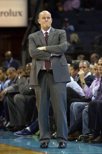 Dec 11, 2013; Charlotte, NC, USA; Charlotte Bobcats head coach Steve Clifford looks on during the first half of the game against the Orlando Magic at Time Warner Cable Arena. Mandatory Credit: Jeremy Brevard-USA TODAY Sports