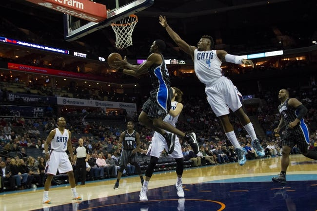 Dec 11, 2013; Charlotte, NC, USA; Orlando Magic shooting guard Victor Oladipo (5) goes up for a shot while Charlotte Bobcats power forward Jeff Adrien (4) defends during the first half at Time Warner Cable Arena. Mandatory Credit: Jeremy Brevard-USA TODAY Sports
