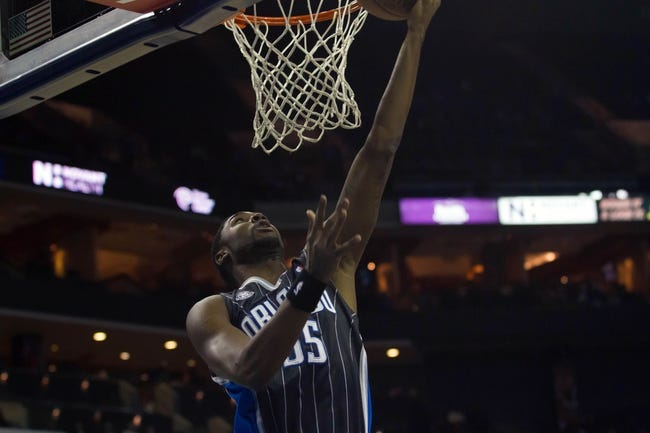 Dec 11, 2013; Charlotte, NC, USA; Orlando Magic point guard E'Twaun Moore (55) shoots the ball during the first half against the Charlotte Bobcats at Time Warner Cable Arena. Mandatory Credit: Jeremy Brevard-USA TODAY Sports