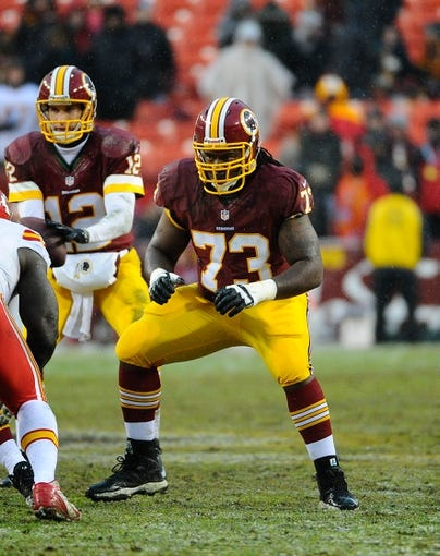 Dec 8, 2013; Landover, MD, USA; Washington Redskins guard Adam Gettis (73) prepares to block against the Kansas City Chiefs during the second half at FedEx Field. The Chiefs won 45 - 10. Mandatory Credit: Brad Mills-USA TODAY Sports