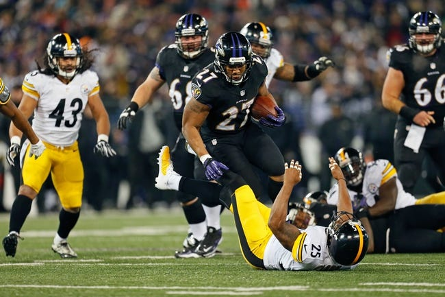 Nov 28, 2013; Baltimore, MD, USA; Baltimore Ravens running back Ray Rice (27) runs over Pittsburgh Steelers safety Ryan Clark (25) during a NFL football game on Thanksgiving at M&T Bank Stadium. Mandatory Credit: Mitch Stringer-USA TODAY Sports
