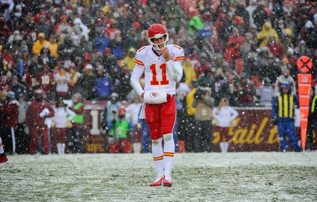 Dec 8, 2013; Landover, MD, USA; Kansas City Chiefs quarterback Alex Smith (11) on the field against the Washington Redskins during the first quarter at FedEx Field. Mandatory Credit: Brad Mills-USA TODAY Sports