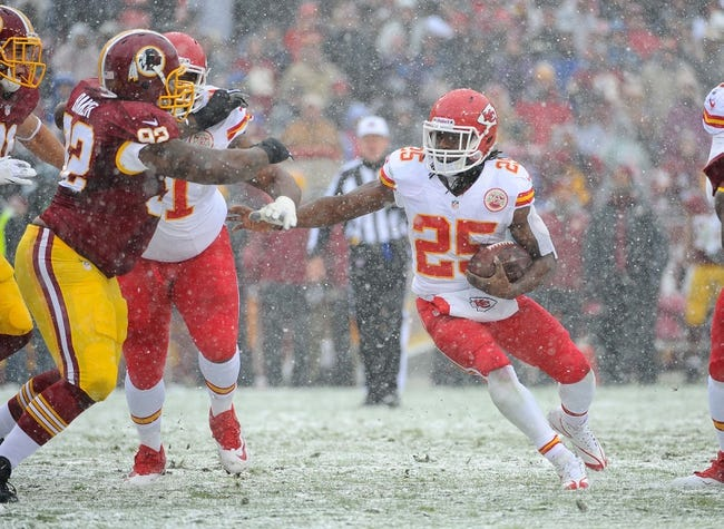 Dec 8, 2013; Landover, MD, USA; Kansas City Chiefs running back Jamaal Charles (25) rushes the ball against the Washington Redskins during the first quarter at FedEx Field. Mandatory Credit: Brad Mills-USA TODAY Sports