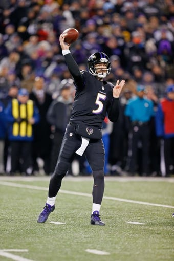 Nov 28, 2013; Baltimore, MD, USA; Baltimore Ravens quarterback Joe Flacco (5) throws a pass against the Pittsburgh Steelers during a NFL football game on Thanksgiving at M&T Bank Stadium. Mandatory Credit: Mitch Stringer-USA TODAY Sports