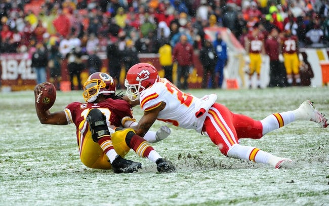 Dec 8, 2013; Landover, MD, USA; Washington Redskins quarterback Robert Griffin III (10) is tackled by Kansas City Chiefs safety Eric Berry (29) during the second quarter at FedEx Field. Mandatory Credit: Brad Mills-USA TODAY Sports