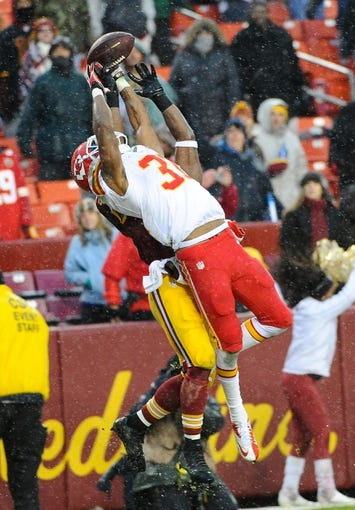 Dec 8, 2013; Landover, MD, USA; Kansas City Chiefs cornerback Marcus Cooper (31) breaks up a pass intended for Washington Redskins wide receiver Pierre Garcon (88) during the second half at FedEx Field. The Chiefs won 45 - 10. Mandatory Credit: Brad Mills-USA TODAY Sports