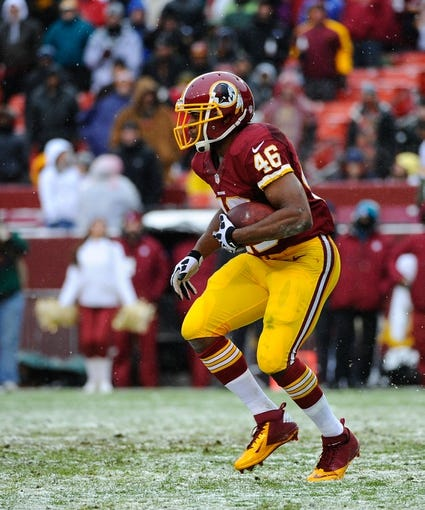 Dec 8, 2013; Landover, MD, USA; Washington Redskins running back Alfred Morris (46) rushes the ball against the Kansas City Chiefs during the second quarter at FedEx Field. Mandatory Credit: Brad Mills-USA TODAY Sports