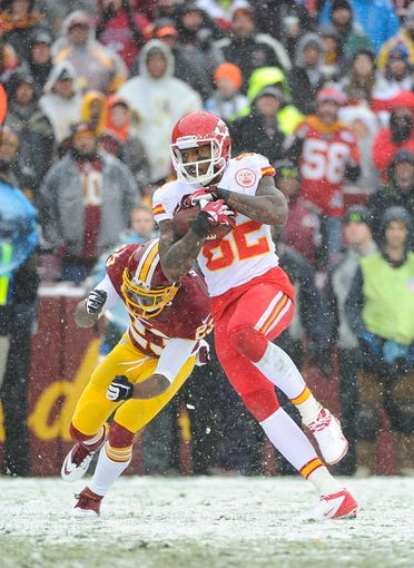 Dec 8, 2013; Landover, MD, USA; Kansas City Chiefs wide receiver Dwayne Bowe (82) runs for a touchdown as Washington Redskins cornerback DeAngelo Hall (23) defends during the first quarter at FedEx Field. Mandatory Credit: Brad Mills-USA TODAY Sports