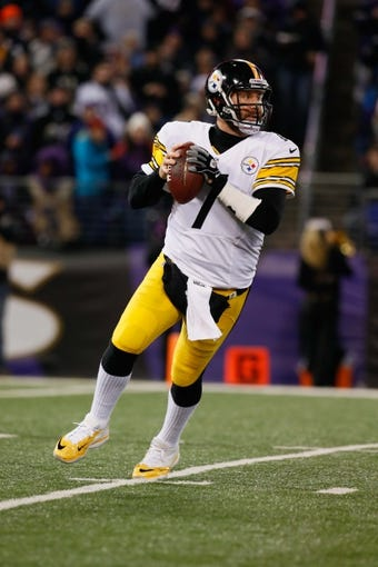 Nov 28, 2013; Baltimore, MD, USA; Pittsburgh Steelers quarterback Ben Roethlisberger (7) looks to pass against the Baltimore Ravens during a NFL football game on Thanksgiving at M&T Bank Stadium. Mandatory Credit: Mitch Stringer-USA TODAY Sports