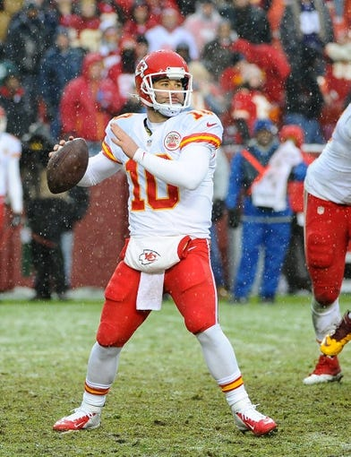 Dec 8, 2013; Landover, MD, USA; Kansas City Chiefs quarterback Chase Daniel (10) drops back to pass against the Washington Redskins during the second half at FedEx Field. The Chiefs won 45 - 10. Mandatory Credit: Brad Mills-USA TODAY Sports