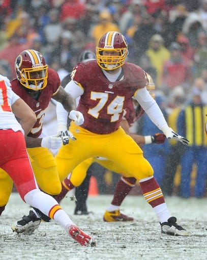 Dec 8, 2013; Landover, MD, USA; Washington Redskins offensive tackle Tyler Polumbus (74) prepares to block against the Kansas City Chiefs during the first quarter at FedEx Field. Mandatory Credit: Brad Mills-USA TODAY Sports