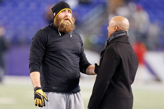 Nov 28, 2013; Baltimore, MD, USA; Pittsburgh Steelers defensive end Brett Keisel (99) talks with NFL announcer Hines Ward prior to the game against the Baltimore Ravens during a NFL football game on Thanksgiving at M&T Bank Stadium. Mandatory Credit: Mitch Stringer-USA TODAY Sports