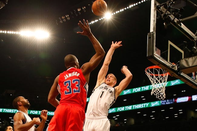 Dec 12, 2013; Brooklyn, NY, USA;  Los Angeles Clippers power forward Antawn Jamison (33) shoots over Brooklyn Nets power forward Mason Plumlee (1) during the first quarter at Barclays Center. Mandatory Credit: Anthony Gruppuso-USA TODAY Sports