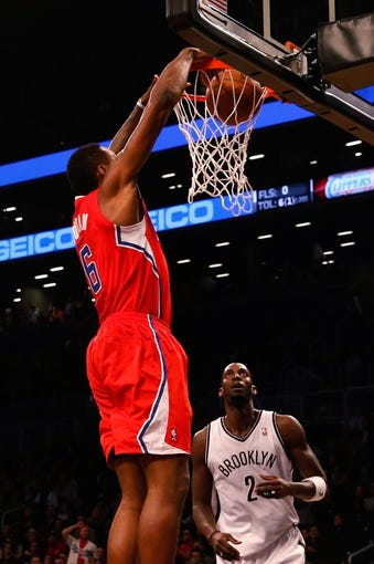 Dec 12, 2013; Brooklyn, NY, USA; Los Angeles Clippers center DeAndre Jordan (6) at the net during the first quarter against the Brooklyn Nets  at Barclays Center. Mandatory Credit: Anthony Gruppuso-USA TODAY Sports