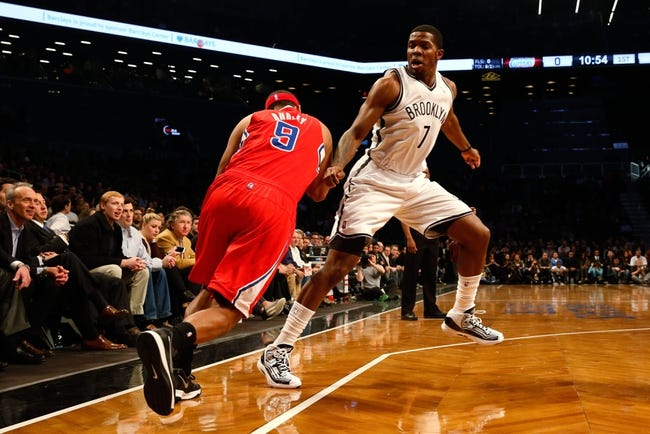 Dec 12, 2013; Brooklyn, NY, USA;  Brooklyn Nets shooting guard Joe Johnson (7) fouls Los Angeles Clippers small forward Jared Dudley (9) during the first quarter at Barclays Center. Mandatory Credit: Anthony Gruppuso-USA TODAY Sports