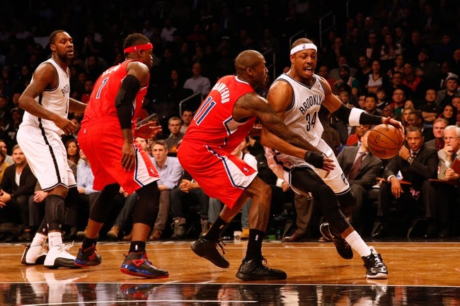 Dec 12, 2013; Brooklyn, NY, USA;  Brooklyn Nets small forward Paul Pierce (34) drives around Los Angeles Clippers shooting guard Jamal Crawford (11) during the third quarter at Barclays Center. Brooklyn Nets won 102-93.  Mandatory Credit: Anthony Gruppuso-USA TODAY Sports