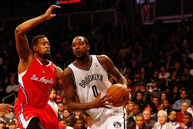 Dec 12, 2013; Brooklyn, NY, USA; Los Angeles Clippers center DeAndre Jordan (6) defends Brooklyn Nets center Andray Blatche (0) during the fourth quarter at Barclays Center. Brooklyn Nets won 102-93.  Mandatory Credit: Anthony Gruppuso-USA TODAY Sports