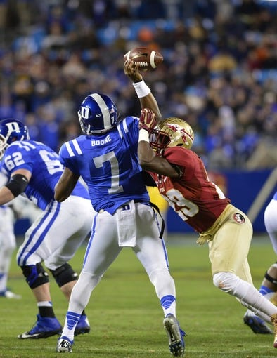 Dec 7, 2013; Charlotte, NC, USA; Florida State Seminoles defensive back Nate Andrews (29) forces a bad pass by Duke Blue Devils quarterback Anthony Boone (7) that is intercepted by the Seminoles in the third quarter at Bank of America Stadium. Mandatory Credit: Bob Donnan-USA TODAY Sports