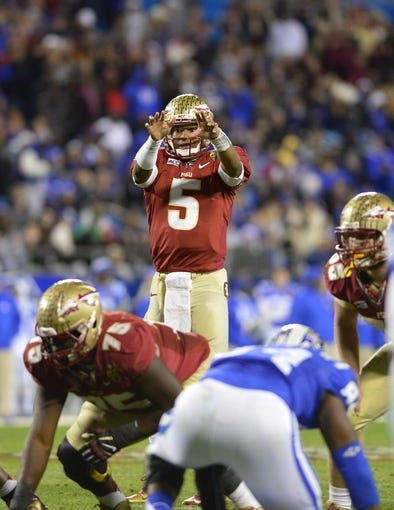 Dec 7, 2013; Charlotte, NC, USA; Florida State Seminoles quarterback Jameis Winston (5) calls signals at the line in the third quarter at Bank of America Stadium. Mandatory Credit: Bob Donnan-USA TODAY Sports