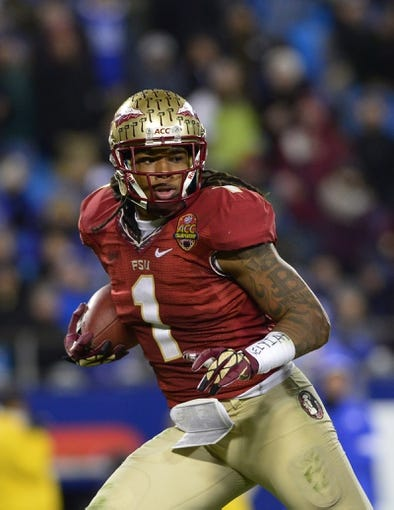 Dec 7, 2013; Charlotte, NC, USA; Florida State Seminoles wide receiver Kelvin Benjamin (1) scores a touchdown in the third quarter at Bank of America Stadium. Mandatory Credit: Bob Donnan-USA TODAY Sports