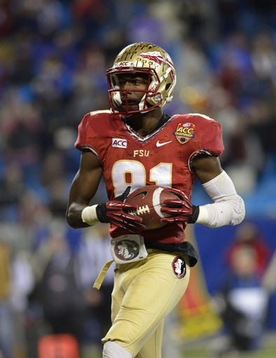 Dec 7, 2013; Charlotte, NC, USA; Florida State Seminoles wide receiver Kenny Shaw (81) in the end zone after a touchdown catch in the third quarter at Bank of America Stadium. Mandatory Credit: Bob Donnan-USA TODAY Sports