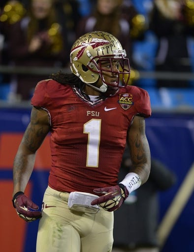 Dec 7, 2013; Charlotte, NC, USA; Florida State Seminoles wide receiver Kelvin Benjamin (1) in the end zone after scoring a touchdown in the third quarter at Bank of America Stadium. Mandatory Credit: Bob Donnan-USA TODAY Sports