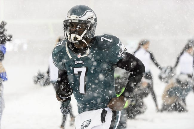 Dec 8, 2013; Philadelphia, PA, USA; Philadelphia Eagles quarterback Michael Vick (7) runs onto the field prior to the game against the Detroit Lions at Lincoln Financial Field. The Eagles defeated the Lions 34-20. Mandatory Credit: Howard Smith-USA TODAY Sports