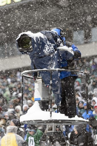 Dec 8, 2013; Philadelphia, PA, USA; A television camera gets covered in snow during the third quarter of a game between the Philadelphia Eagles and the Detroit Lions at Lincoln Financial Field. The Eagles defeated the Lions 34-20. Mandatory Credit: Howard Smith-USA TODAY Sports