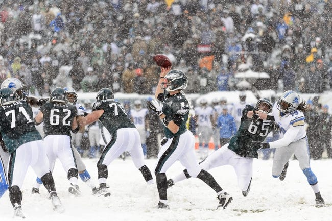 Dec 8, 2013; Philadelphia, PA, USA; Philadelphia Eagles quarterback Nick Foles (9) passes the ball during the third quarter against the Detroit Lions at Lincoln Financial Field. The Eagles defeated the Lions 34-20. Mandatory Credit: Howard Smith-USA TODAY Sports