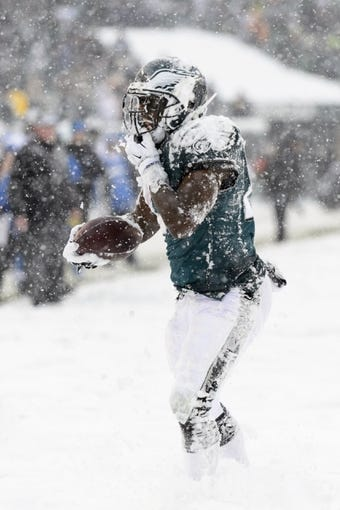 Dec 8, 2013; Philadelphia, PA, USA; Philadelphia Eagles running back LeSean McCoy (25) gets up after being tackled during the third quarter against the Detroit Lions at Lincoln Financial Field. The Eagles defeated the Lions 34-20. Mandatory Credit: Howard Smith-USA TODAY Sports