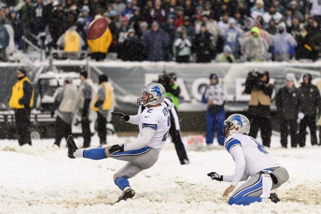 Dec 8, 2013; Philadelphia, PA, USA; The football comes back as Detroit Lions place kicker David Akers (2) PAT attempt is blocked during the fourth quarter against the Philadelphia Eagles at Lincoln Financial Field. The Eagles defeated the Lions 34-20. Mandatory Credit: Howard Smith-USA TODAY Sports