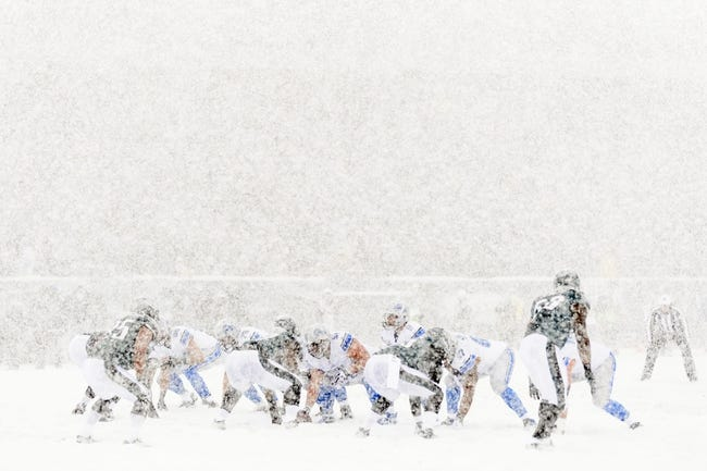 Dec 8, 2013; Philadelphia, PA, USA; Detroit Lions quarterback Matthew Stafford (9) under center during the first quarter against the Philadelphia Eagles at Lincoln Financial Field. The Eagles defeated the Lions 34-20. Mandatory Credit: Howard Smith-USA TODAY Sports