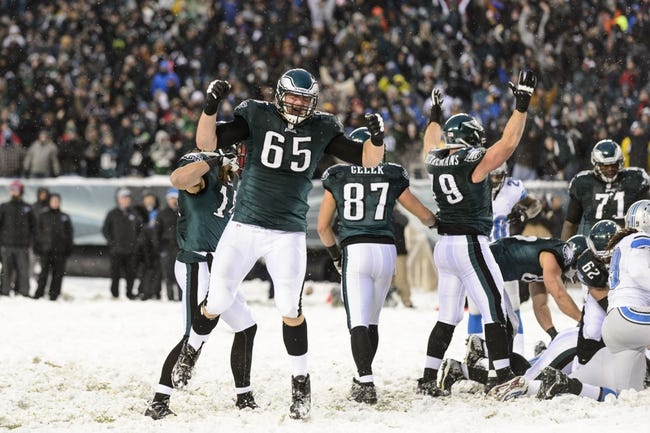 Dec 8, 2013; Philadelphia, PA, USA; Philadelphia Eagles offensive tackle Lane Johnson (65) celebrates a quarterback sneak for a touchdown during the fourth quarter against the Detroit Lions at Lincoln Financial Field. The Eagles defeated the Lions 34-20. Mandatory Credit: Howard Smith-USA TODAY Sports