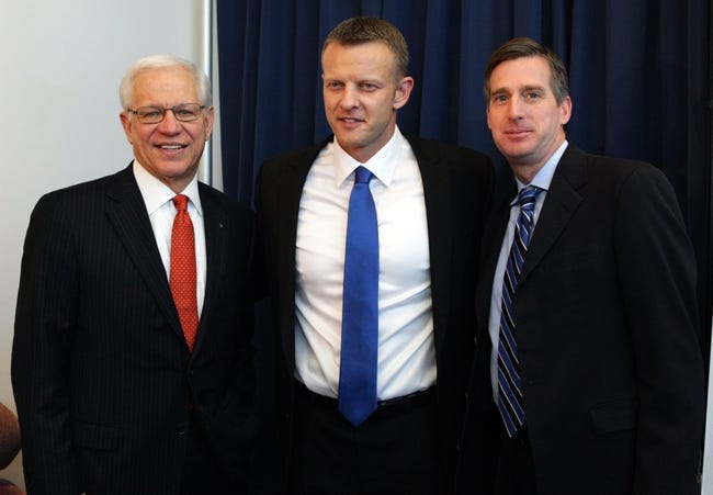 Dec 13, 2013; Boise, ID, USA; Boise State pesident Dr Bob Kustra (left,) new head football coach Bryan Harsin, (center) and athletic director Mark Coyle at a press conference announcing the hire of Harsin as the new head coach at Boise State.  Mandatory Credit: Brian Losness-USA TODAY Sports