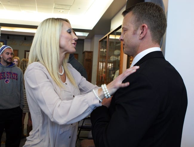 Dec 13, 2013; Boise, ID, USA; Boise State Broncos new head football coach Bryan Harsin and his wife Kes Harsin share a moment after the press conference announcing his return to Boise State to be the head coach of the Broncos.  Mandatory Credit: Brian Losness-USA TODAY Sports