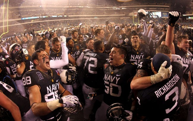 Dec 14, 2013; Philadelphia, PA, USA; Navy Midshipmen wide receiver Casey Bolena (88) and linebacker Don Pearson (50) celebrate a 34-7 win over Army at Lincoln Financial Field. Mandatory Credit: Danny Wild-USA TODAY Sports