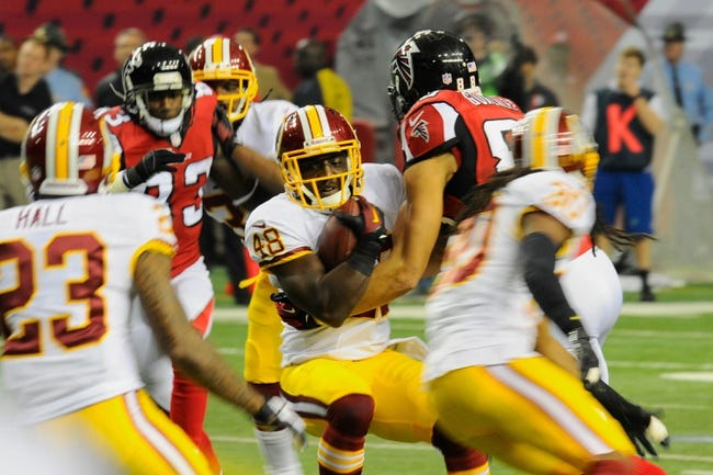Dec 15, 2013; Atlanta, GA, USA; Washington Redskins defensive back Jose Gumbs (48) intercepts a pass against the Atlanta Falcons during the second quarter at the Georgia Dome. Mandatory Credit: Dale Zanine-USA TODAY Sports