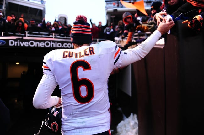 Dec 15, 2013; Cleveland, OH, USA; Chicago Bears quarterback Jay Cutler (6) walks off the field after defeating the Cleveland Browns 38-31 at FirstEnergy Stadium. Mandatory Credit: Andrew Weber-USA TODAY Sports