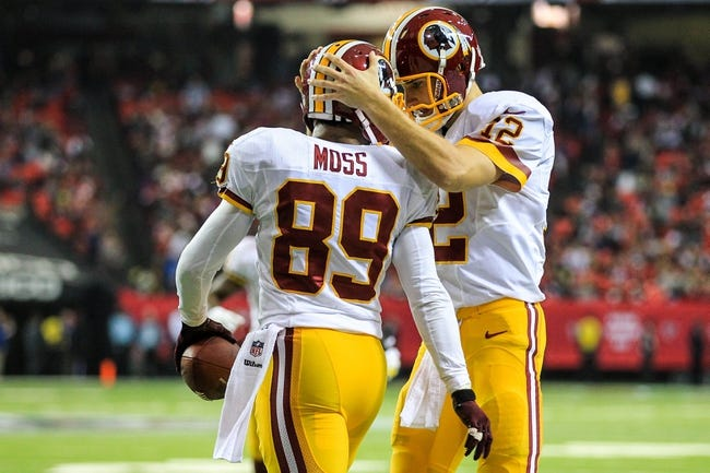 Dec 15, 2013; Atlanta, GA, USA; Washington Redskins quarterback Kirk Cousins (12) celebrates a touchdown with wide receiver Santana Moss (89) in the second half against the Atlanta Falcons at the Georgia Dome. The Falcons won 27-26. Mandatory Credit: Daniel Shirey-USA TODAY Sports